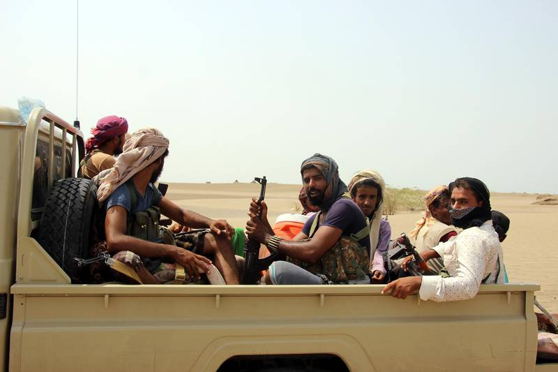 epa07004140 Yemeni government forces take part in military operations on Houthi positions in the port province of Hodeidah, Yemen, 07 September 2018. According to reports, heavy fighting is currently taking place at Yemeni Hodeidah city's western and southern outskirts between the Saudi-backed Yemeni forces and the Houthi rebels as UN-sponsored peace talks in Geneva failed to get off the ground, with the Houthi delegation refusing to leave the capital Sana'a.  EPA/NAJEEB ALMAHBOOBI