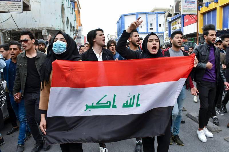 """Iraqi students take part in an anti-government march calling for an overhaul of the political system and a non-controversial prime minister, in the southern Iraqi city of Nasiriyah on february 16, 2020. - While Iraq's premier-designate Mohammad Allawi promised on February 15 to form a cabinet stacked with """"independents"""", demonstrators still consider him too close to the political elite that has governed Iraq since the 2003 US-led invasion and that they want to see gone. (Photo by Asaad NIAZI / AFP)"""