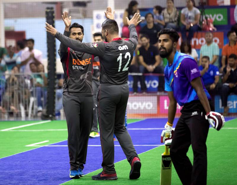 Dubai, United Arab Emirates - September 21st, 2017: Isuru Umesh of the UAE takes a wicket during the game between the UAE v Malaysia in the W.I.C.F Indoor cricket world cup 2017. Thursday, Sept 21st, 2017, Insportz, Al Quoz, Dubai. Chris Whiteoak / The National