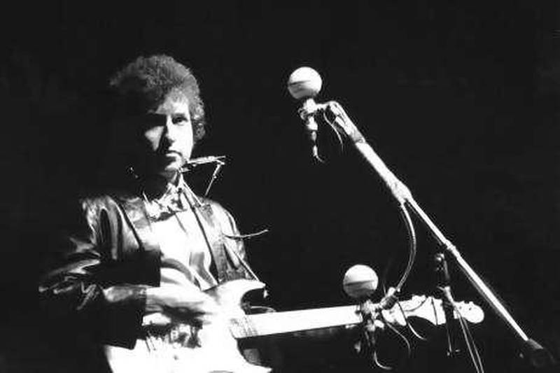UNITED STATES - CIRCA 1965:  Photo of Bob Dylan at the Newport Folk Festival  (Photo by Alice Ochs/Michael Ochs Archives/Getty Images)