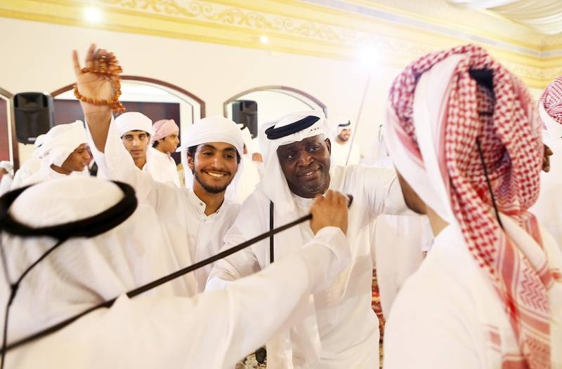 ABU DHABI , UNITED ARAB EMIRATES - JULY 5 : Bilal Antara Shadah Al Mazrouei ( center right ) dancing with the guests during the local marriage celebration at Baniyas wedding hall in Abu Dhabi.  ( Pawan Singh / The National ) Story by Haneen Dajani