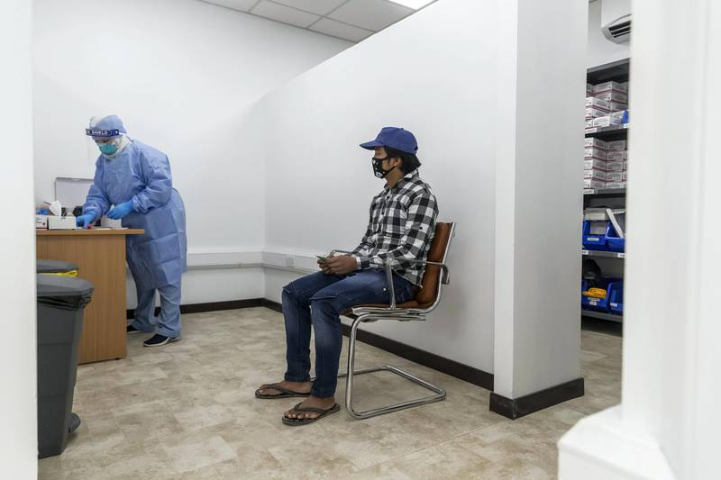 ABU DHABI, UNITED ARAB EMIRATES. 16 APRIL 2020. COVID-19 Testing station in Al Mussafah. A man gets tested inside the testing facility for COVID-19. (Photo: Antonie Robertson/The National) Journalist: Haneen Dajani. Section: National.