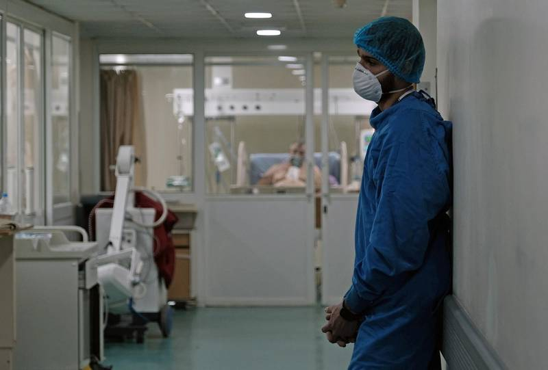 A medical staff member, wearing protective gear, stands at an intensive care unit for patients suffering from the coronavirus disease (COVID-19), at Rafik Hariri University Hospital, in Beirut, Lebanon January 19, 2021. Picture taken January 19, 2021. REUTERS/Emilie Madi.  NO RESALES. NO ARCHIVES