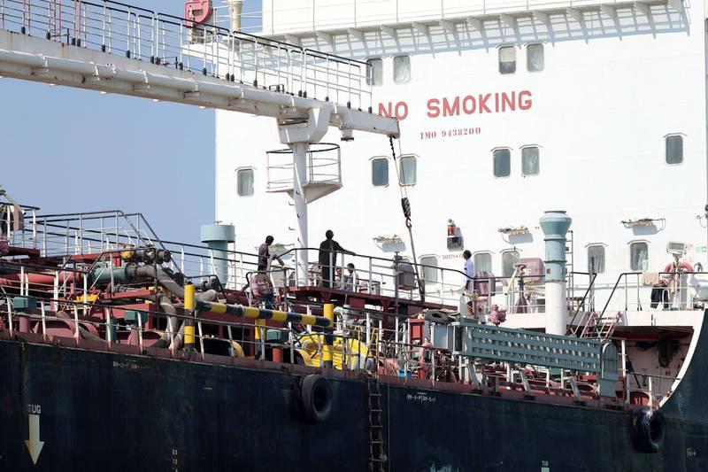 Umm Al Quwain, United Arab Emirates - Reporter: N/A. News. People prepare to tow the Mt Iba oil tanker that ran aground in Umm Al Quwain. Tuesday, February 16th, 2021. Dubai. Chris Whiteoak / The National