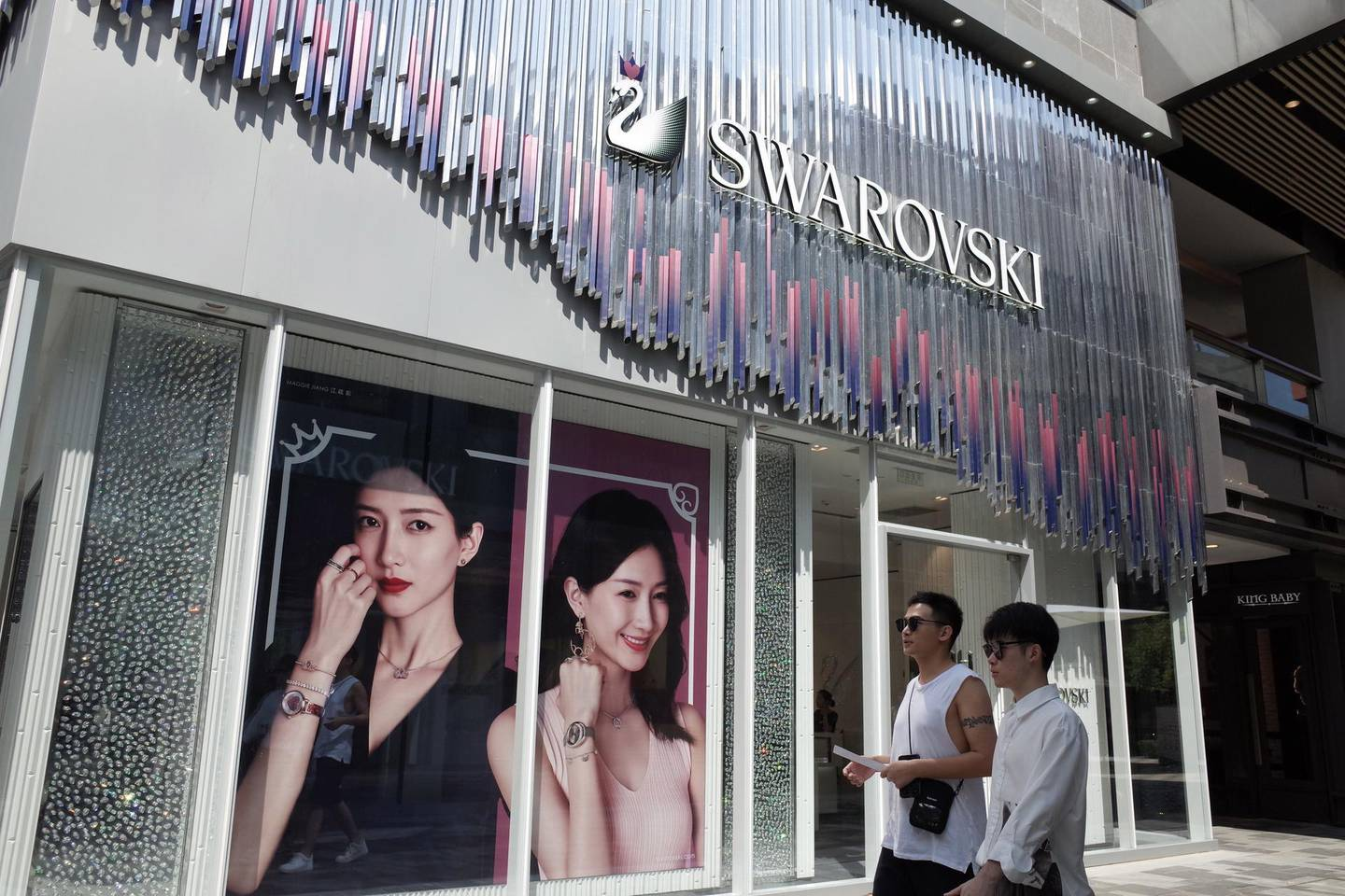 epa07770729 People walk pass by a Swarovski store in a commercial district in Beijing, China, 13 August 2019. Fashion brands Versace and Coach apologize to Chinese customers after social media users called for a boycott of the brands due to separate T-shirts from both fashion houses that suggested Hong Kong and Taipei were separate from China. And also Swarovski apologizes to Chinese customers for erroneously describing Hong Kong as a country on its website.  EPA/WU HONG