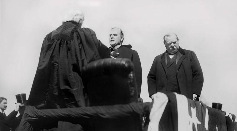 Chief Justice Melville Weston Fuller Administering Oath of Office to President William McKinley, Former President Grover Cleveland on Right, U.S. Capitol, Washington DC, USA, March 4, 1897. (Photo by: Glasshouse Vintage/Universal History Archive/Universal Images Group via Getty Images)