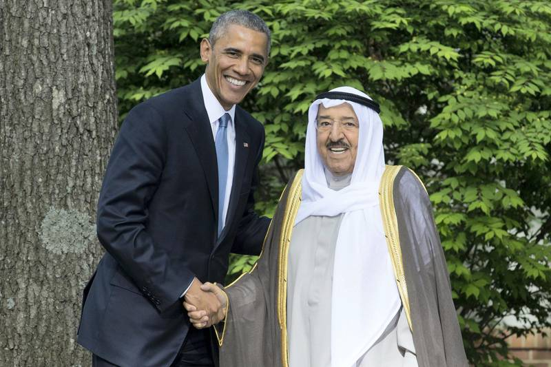 epa04748980 US President Barack Obama (L) shakes hands with Sheikh Sabah Al-Ahmad Al-Jaber Al-Sabah (R), Amir of the State of Kuwait, at Camp David, Maryland, USA, 14 May 2015. Obama met with  leaders from six Gulf nations; Bahrain, Kuwait, Oman, Qatar, Saudi Arabia and the United Arab Emirates to discuss security cooperation in the face of regional conflicts.  EPA/MICHAEL REYNOLDS *** Local Caption *** 51934264