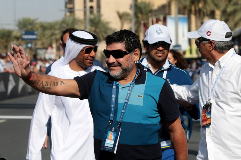 Dubai, United Arab Emirates, February 8, 2014:      Diego Maradona waves to the crowd ahead of the finish of the fourth stage of the Dubai Tour cycling race in Dubai on February 8, 2014. Christopher Pike / The National  Reporter: Paul Radley Section: Sport