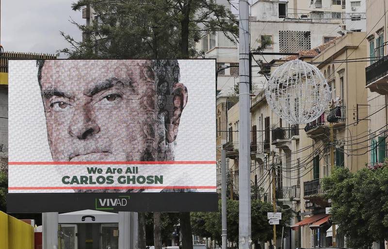 A portrait of ousted Nissan chairman Carlos Ghosn is seen on a publicity billboard in his support at a street in Beirut on December 6, 2018. - Ghosn, born in Brazil of Lebanese descent, was arrested on November 19, 2018 in Tokyo over alleged financial misconduct. He is facing further accusation of under-reporting his salary by about $35.5 million over the last three years. (Photo by JOSEPH EID / AFP)