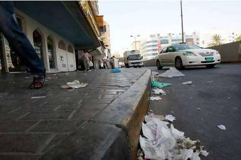 SHARJAH, UNITED ARAB EMIRATES, July 11: People walking on the street with full of litter on the road and streets at Rolla area in Sharjah.  (Pawan Singh / The National) For News. Story by Yasin