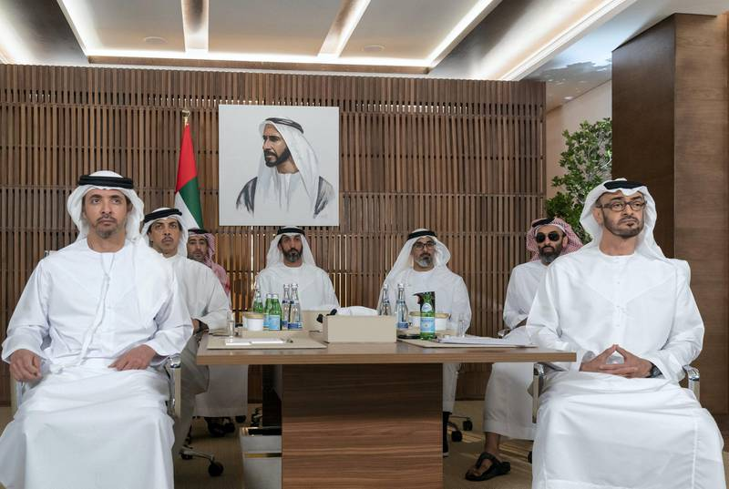 ABU DHABI, UNITED ARAB EMIRATES - March 16, 2020: HH Sheikh Mohamed bin Zayed Al Nahyan, Crown Prince of Abu Dhabi and Deputy Supreme Commander of the UAE Armed Forces (R), receives a briefing via video conference from the Covid19 working group in the HQ of the National Emergency Crisis and Disasters Management Authority (NCEMA) (not shown).    Seen with HH Sheikh Tahnoon bin Zayed Al Nahyan, UAE National Security Advisor (2nd R), HH Major General Sheikh Khaled bin Mohamed bin Zayed Al Nahyan, Deputy National Security Adviser,member of theAbu Dhabi Executive CouncilandChairman of Abu Dhabi Executive Office (3rd R), HE Mohamed Mubarak Al Mazrouei, Undersecretary of the Crown Prince Court of Abu Dhabi (4th R), HE Ali Saeed Al Neyadi, President and Commissioner of the Customs and Authority (5th R), HH Sheikh Mansour bin Zayed Al Nahyan, UAE Deputy Prime Minister and Minister of Presidential Affairs (6th R) and HH Sheikh Hazza bin Zayed Al Nahyan, Vice Chairman of the Abu Dhabi Executive Council (L).   ( Mohamed Al Hammadi / Ministry of Presidential Affairs ) ---