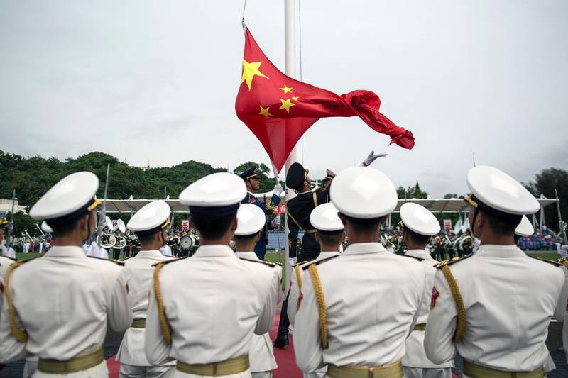 epa06083053 (FILE) - People's Liberation Army (PLA) soldiers participate in a flag raising ceremony during an open day at the PLA navy base in Hong Kong, China, 08 July 2017 (reissued 12 July 2017). According to reports, China ships carrying military personnel departed on 11 July 2017 from Zhanjiang, southern China and set sails to Djibouti. China is to establish it's fiorst ever overseas military base in the Djibouti, at the Horn of Africa.  EPA/JEROME FAVRE *** Local Caption *** 53634628