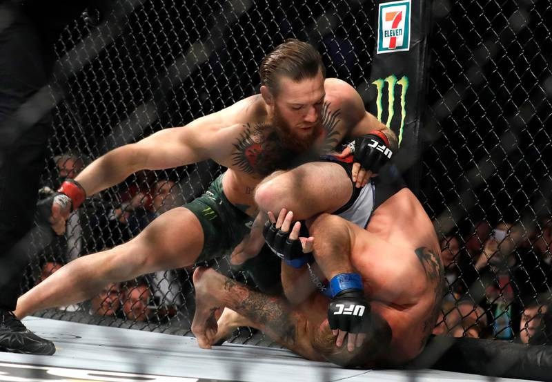 LAS VEGAS, NEVADA - JANUARY 18: Conor McGregor (L) punches Donald Cerrone in a welterweight bout during UFC246 at T-Mobile Arena on January 18, 2020 in Las Vegas, Nevada. McGregor won by first-round TKO.   Steve Marcus/Getty Images/AFP