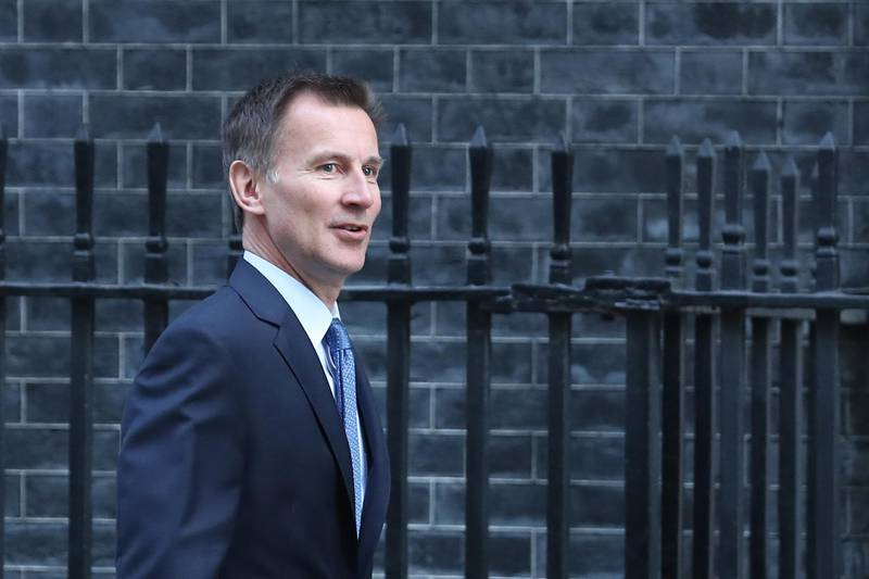 Britain's Foreign Secretary Jeremy Hunt arrives for the weekly cabinet meeting at 10 Downing Street in London on February 26, 2019. Prime Minister Theresa May faced the threat Tuesday of more ministerial resignations over her refusal to rule out the possibility of Britain crashing out of the European Union without a deal on March 29. / AFP / Daniel LEAL-OLIVAS