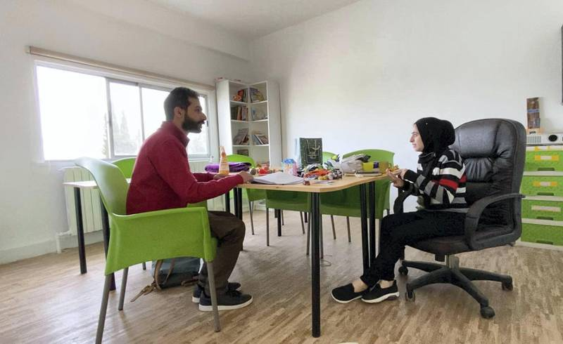 Arabic teachers discuss work at the Misbah Centre in Jabal Al Weibdeh. Amy McConaghy / The National