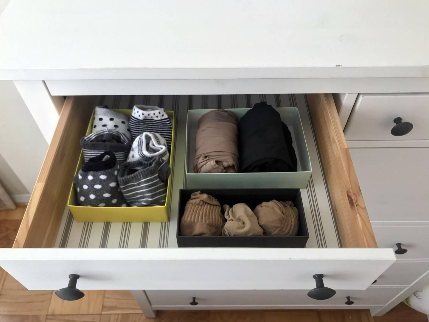 """Socks and tights are seen arranged in a drawer in small boxes at a home in Washington, DC, as recommended by Japanese tidying expert Marie Kondo, creator of the """"KonMari"""" method, on January 18, 2019. Marie Kondo is small of stature, but her tidying philosophy has reached stratospheric heights. Her book, """"The Life Changing Magic of Tidying Up,"""" has earned a cult following since its publication in the US in 2014 -- but it is the 34-year-old's new Netflix show, """"Tidying up with Marie Kondo"""" that has everyone talking. / AFP / Sara KAMOUNI / TO GO WITH AFP STORY by Sara KAMOUNI, """"Japanese tidying guru sparks joy with cluttered Americans"""""""