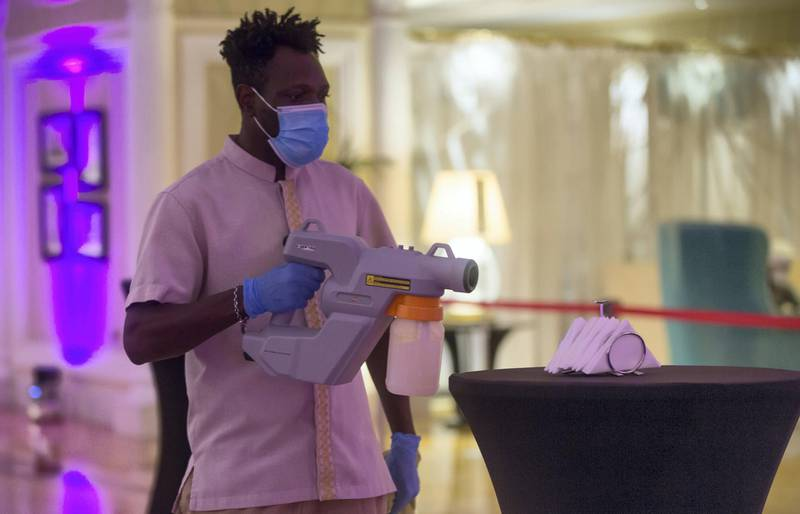Ras Al Khaimah, United Arab Emirates: A cleaner disinfecting the area for the new year party at Waldorf Astoria, Al Hamra Island, RAK.  Leslie Pableo for The National