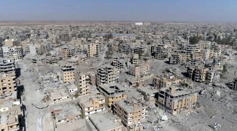 """FILE -- In this Thursday, Oct. 19, 2017 file photo, a frame grab made from drone video shows damaged buildings in Raqqa, Syria. Amnesty International, an international rights group, urged the U.S.-led military coalition battling the Islamic State group to investigate airstrikes that killed civilians in the campaign to liberate the Syrian city of Raqqa from the extremists. Amnesty  said the U.S.-coalition's admission last month that it killed 78 more civilians than previously reported in the 2017 assault on Raqqa was just the """"tip of the iceberg."""" (AP Photo/Gabriel Chaim, File)"""