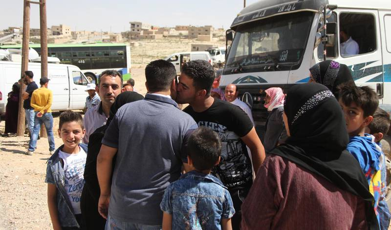 epa06906675 Displaced Syrians hug each others upon their return from Lebanon, through al-Zamrani corridor to their homes in al-Qalamoun area in Damascus countryside, Syria, 23 July 2018. According to media reports, Lebanon hosts 1,011,366 Syrian refugees registered with UNHCR, Including 80 thousand refugees living in seven camps in the city of Arsal. Some 900 displaced Syrians would return. this is the third batch of displaced Syrians, who have recently returned to their homeland.  EPA/STR
