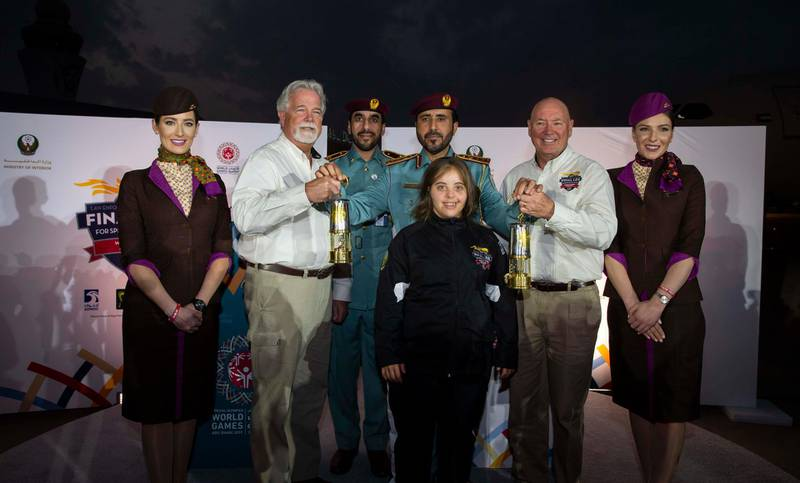 Special Olympics Ambassador Chaica Al Qassimi with the Guardians of the Flame and the World Games Flame of Hope. Courtesy Etihad