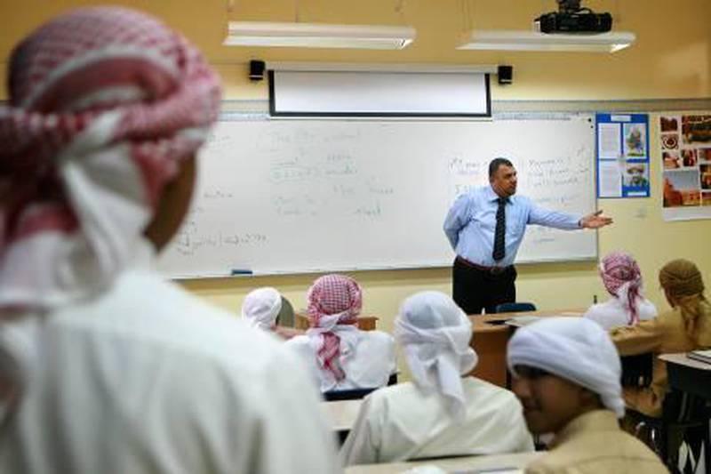 Abu Dhabi - September 28, 2009: Students at Al Ittihad Model School study english in class.  ( Philip Cheung / The National )    *** Local Caption ***  PC0010-SchoolStock.JPG