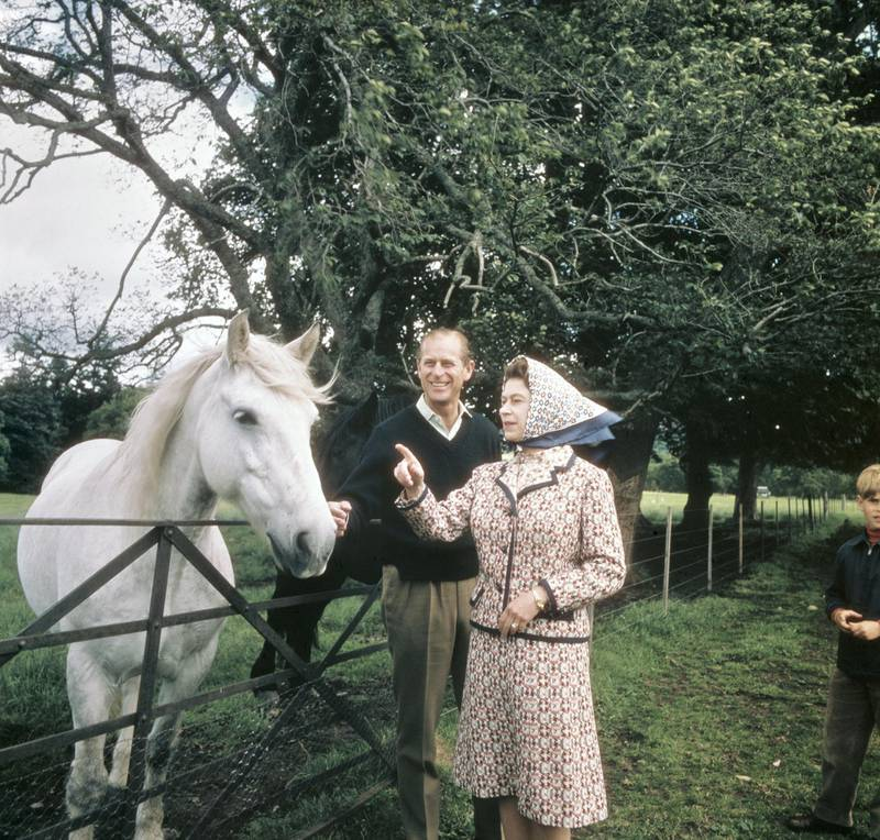 Queen Elizabeth II and Prince Philip visit a farm on the Balmoral estate in Scotland, during their Silver Wedding anniversary year, September 1972. (Photo by Fox Photos/Hulton Archive/Getty Images)