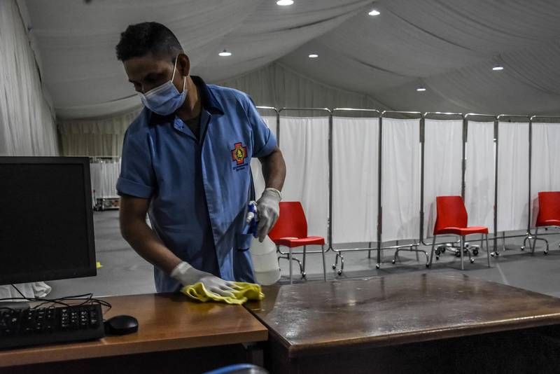 Beirut, Lebanon, 13 February, 2021. A janitor disinfects surfaces as a new vaccine center is set up at St George's hospital, on the eve of Lebanons Covid-19 vaccine roll-out. Lebanon is preparing to receive its first, Pfizer-Biontech Covid-19 vaccines.