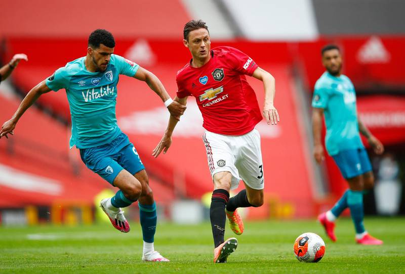 """Soccer Football - Premier League - Manchester United v AFC Bournemouth - Old Trafford, Manchester, Britain - July 4, 2020 Bournemouth's Dominic Solanke in action with Manchester United's Nemanja Matic, as play resumes behind closed doors following the outbreak of the coronavirus disease (COVID-19) Clive Brunskill/Pool via REUTERS  EDITORIAL USE ONLY. No use with unauthorized audio, video, data, fixture lists, club/league logos or """"live"""" services. Online in-match use limited to 75 images, no video emulation. No use in betting, games or single club/league/player publications.  Please contact your account representative for further details."""