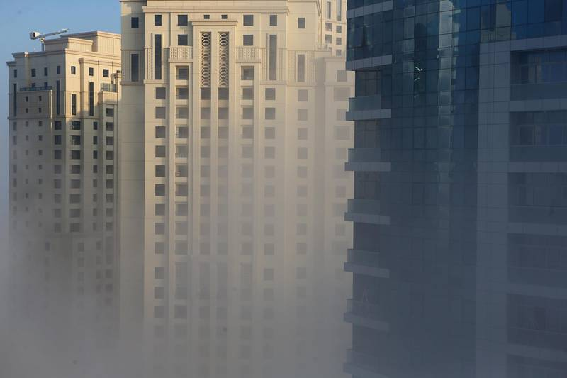 DUBAI, UAE. January 8, 2015 - Morning fog sweeps over Dubai Marina, January 8, 2015. (Photos by: Sarah Dea/The National, Story by: Standalone, News) *** Local Caption ***  SDEA080115-fog09.JPG