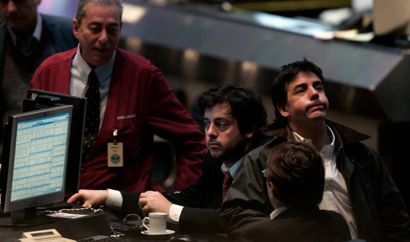 Traders work on the floor of the Buenos Aires Stock Exchange in Buenos Aires August 10, 2007. Global stock markets, including those in Argentina, fell and high-yielding currencies lost value on Friday, even as central banks pumped extra cash into the financial system to help temper fears of a liquidity crisis gripping investors. REUTERS/Marcos Brindicci (ARGENTINA)