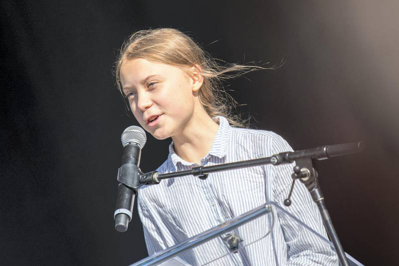 """Swedish climate activist Greta Thunberg speaks to the crowd of protesters during the global climate strike in Montreal, Canada, on September 27 2019. - Teen activist Greta Thunberg called on Canadian Prime Minister Justin Trudeau and other world leaders Friday to do more for the environment, as she prepared to lead a march in Montreal that was part of a wave of global """"climate strikes."""" (Photo by Martin OUELLET-DIOTTE / MARTIN OUELLET-DIOTTE / AFP / AFP)"""