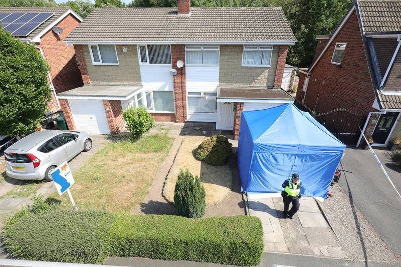 CHESTER, ENGLAND - JULY 04:  (Editors Note: Number plate of unrelated vehicle has been pixelated) A police officer stands outside a house in Chester after a healthcare professional working at the Countess of Chester Hospital was arrested on suspicion of murdering eight babies and attempting to kill six others, on July 4, 2018 in Chester, United Kingdom. A female health care worker at the Countess of Chester Hospital has been arrested on suspicion of murdering eight babies. Cheshire Police having been have been investigating the deaths of 17 newborns at the neonatal unit between March 2015 and July 2016.  (Photo by Christopher Furlong/Getty Images)