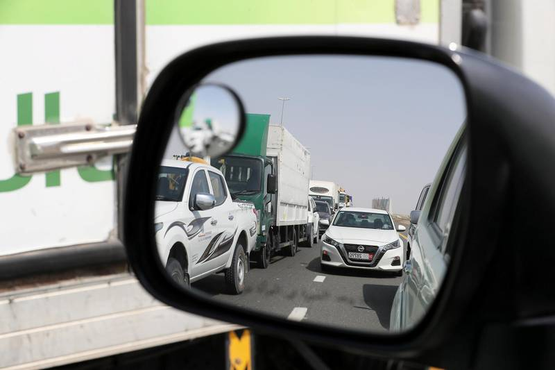 DUBAI, UNITED ARAB EMIRATES , June 2 – 2020 :- Traffic jam at the Dubai border going towards Abu Dhabi on Sheikh Zayed road in Dubai. Abu Dhabi Police checking the movement permits at the police checkpoint on the Dubai – Abu Dhabi border on Sheikh Zayed road in Dubai. Abu Dhabi impose one week ban starting from Tuesday on travel on entering and leaving the emirate to reduce the spread of Covid-19  and ensure its huge testing drive works. (Pawan Singh / The National) For News/Online