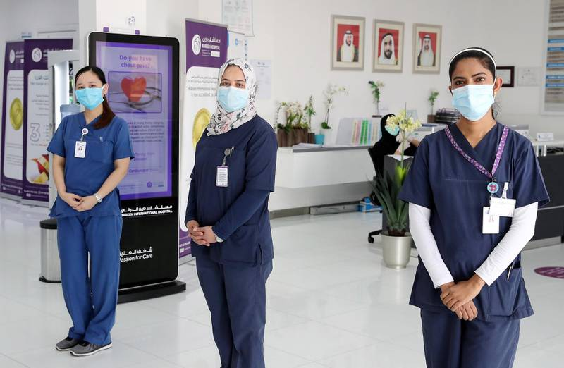 ABU DHABI, UNITED ARAB EMIRATES , May 11 – 2020 :- Left to Right-  Shane Simeon Galang from Philippines,  Mervat Aslan Mhgoub Mohamed from Egypt and Sowmya Kotian from India working as a nurse at the Bareen International Hospital in Mohammed bin Zayed City in Abu Dhabi. (Pawan Singh / The National) For News. Story by Nick Webster
