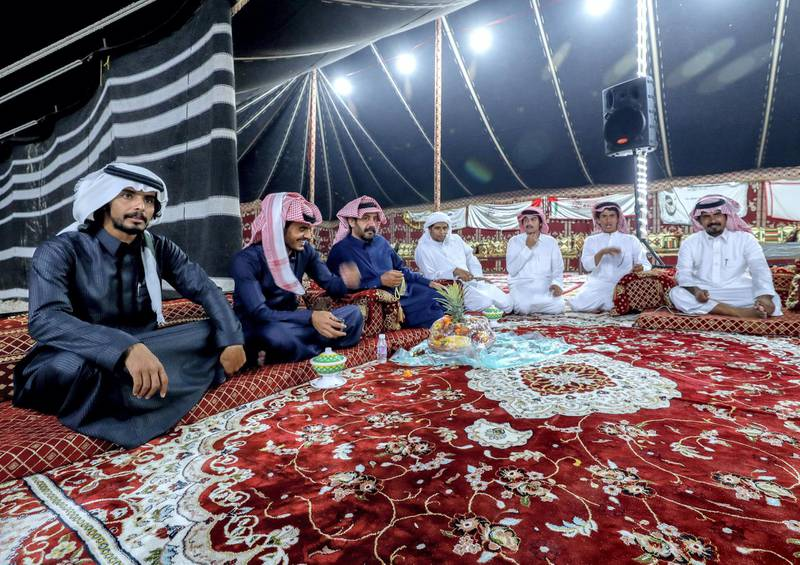 Abu Dhabi, United Arab Emirates, December 10, 2019.    --Men of the Dawasr tribe from Saudi Arabia relax after a victory at the Al Dhafra Festival in Abu Dhabi, UAE.Victor Besa/The NationalSection:  NAReporter:  Anna Zacharias
