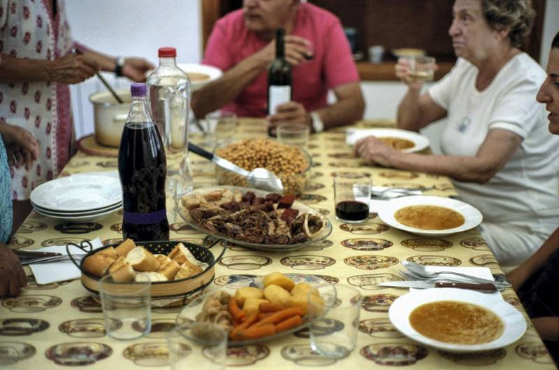 """Spanish family eating the typical """"cocido madrileño"""" at home"""
