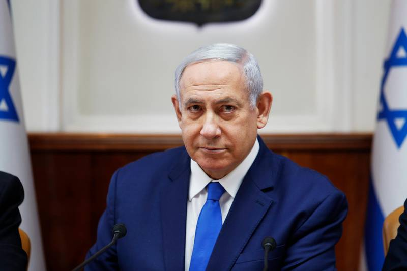"""FILE - In this July 14, 2019, file photo, Israel's Prime Minister Benjamin Netanyahu attends the weekly cabinet meeting in Jerusalem. Israeli Prime Minister Netanyahu is reaffirming his pledge to impose Israeli sovereignty on West Bank settlements. Speaking Sunday, Sept. 1, at a ceremony opening the new school year in the settlement of Elkana, Netanyahu says there """"will be no more displacements"""" and all the communities will be """"part of the state of Israel."""" (Ronen Zvulun/Pool Photo via AP, File)"""