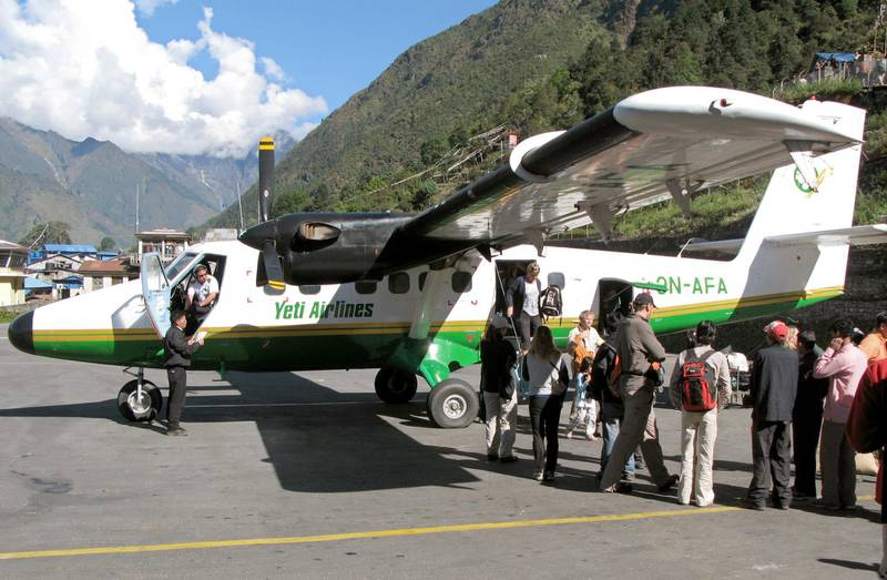 (FILE) - The file picture dated October 2007 shows tourists disembarking an aircraft of the type Twin Otter of Yetio Airlines after its arrival on the runway of the airport Lukla in Nepal. A propeller plane of the same type crashed at the Tenzing-Hillary-Airport in the Himalaya in 3,000 metres height on 08 October 2008. 18 people died in the accident, among them were 12 Germans. The airplane of Yeti Airlines had left the Nepalese capital Kathmandu in the morning of 08 October. Due to its runway between a steep slope on one side and a crag on the other side, the airport Lukla, located 150 kilometres to the north-east, is one of the most dangerous in the world. Photo by: Joern Bender/picture-alliance/dpa/AP Images