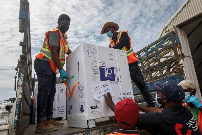 Boxes of AstraZeneca COVID-19 vaccine manufactured by the Serum Institute of India and provided through the global COVAX initiative arrive at the airport in Mogadishu, Somalia Monday, March 15, 2021. The first shipment of 300,000 doses of the AstraZeneca coronavirus vaccine will target the country's frontline workers, elderly and people with chronic health conditions, according to Somalia's Ministry of Health. (AP Photo/Farah Abdi Warsameh)