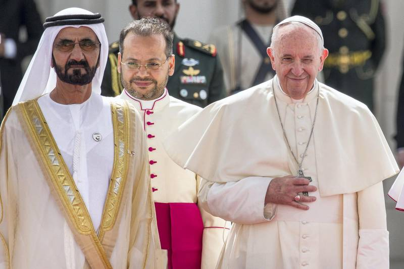 04 February 2019, United Arab Emirates, Abu Dhabi: Pope Francis (R) smiles next to Dubai ruler Sheikh Mohammed bin Rashid Al-Maktoum upon his arrival to the presidential palace. The Pope is on the first ever papal visit to the Arab Peninsula. Photo: Gehad Hamdy/dpa (Photo by Gehad Hamdy/picture alliance via Getty Images)
