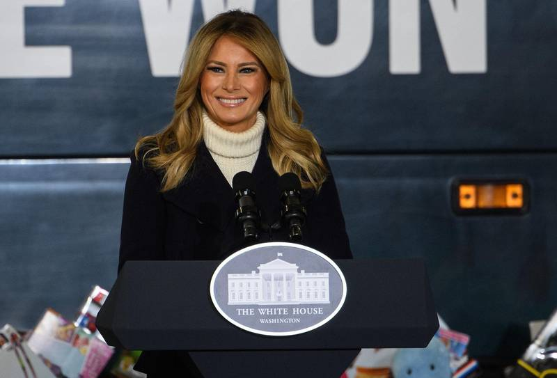 """(FILES) In this file photo taken on December 8, 2020 US First Lady Melania Trump addresses the Marines Toys for Tots drive at Joint Base Base Anacostia Bolling in Washington, DC. First Lady Melania Trump released a farewell message on January 18, 2021 as she prepares to leave the White House, saying that """"violence is never the answer,"""" weeks after the president's supporters stormed the US Capitol. / AFP / NICHOLAS KAMM"""