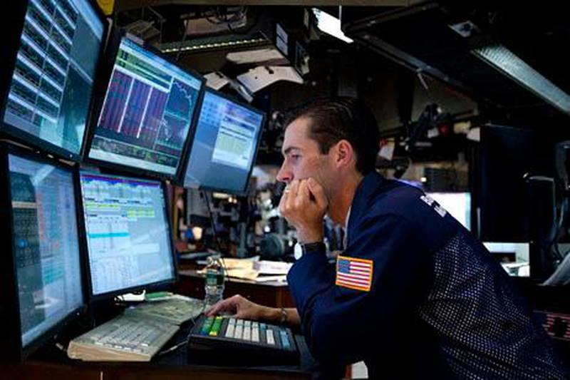 In this Aug. 4, 2011 photo, a trader works on the floor of the New York Stock Exchange. Global stock markets tumbled Friday, Aug. 5, amid fears the U.S. may be heading back into recession and Europe's debt crisis is worsening. The sell-off follows the biggest one-day points decline on Wall Street since the 2008 financial crisis. (AP Photo/Jin Lee) *** Local Caption ***  Wall Street.JPEG-07387.jpg
