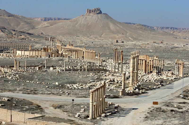 The Fakhr al-Din II's citadel overlooks the ancient Roman-era city of Palmyra with a view of the Great Colonnade on February 7, 2021 in Syria's central province of Homs. - Syria has six sites listed on the UNESCO elite list of world heritage and all of them sustained some level of damage in the 10-year war. Besides Palmyra and Aleppo, the ancient cities of Damascus and Bosra also sustained some damage. (Photo by LOUAI BESHARA / AFP)