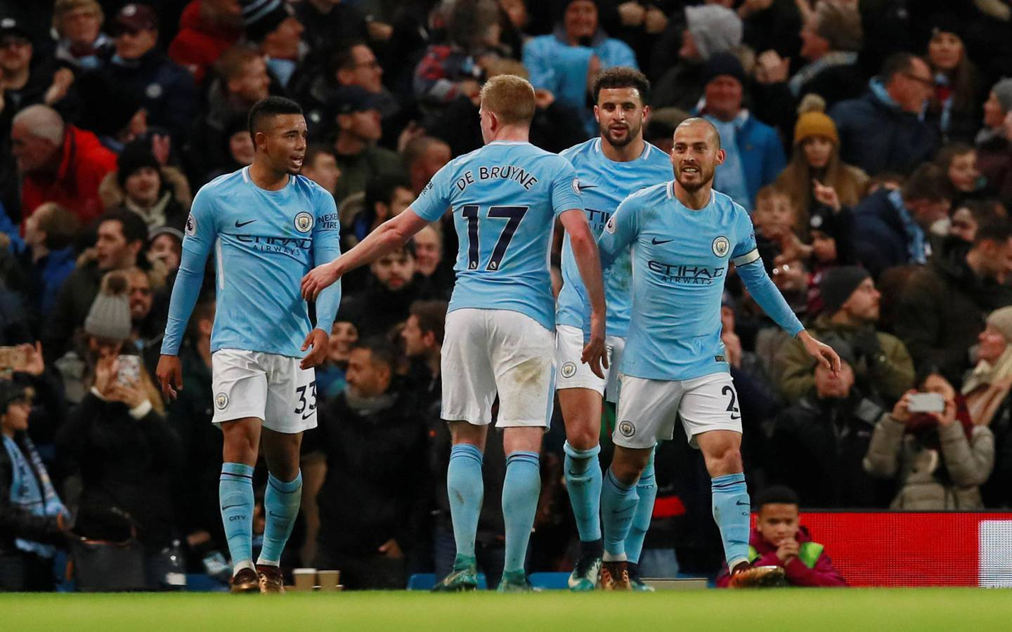 """Soccer Football - Premier League - Manchester City vs West Ham United - Etihad Stadium, Manchester, Britain - December 3, 2017   Manchester City's David Silva celebrates scoring their second goal with Kevin De Bruyne and Gabriel Jesus     Action Images via Reuters/Jason Cairnduff    EDITORIAL USE ONLY. No use with unauthorized audio, video, data, fixture lists, club/league logos or """"live"""" services. Online in-match use limited to 75 images, no video emulation. No use in betting, games or single club/league/player publications. Please contact your account representative for further details."""