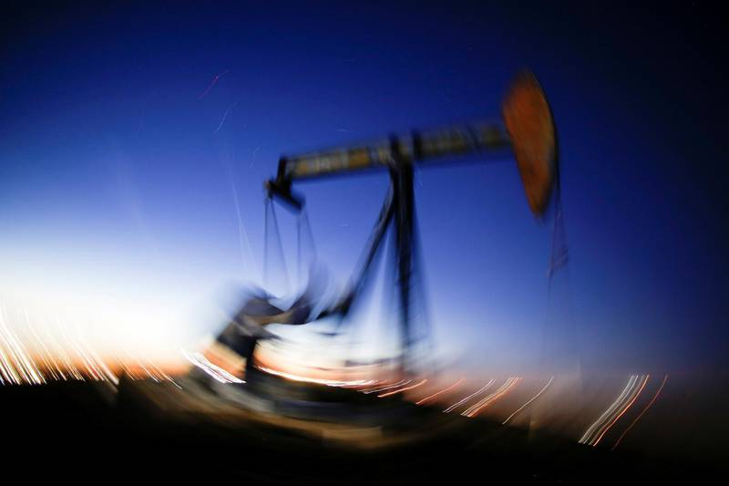 FILE PHOTO: A long exposure image shows the movement of a crude oil pump jack in the Permian Basin in Loving County, Texas, U.S., November 23, 2019. Picture taken November 23, 2019. REUTERS/Angus Mordant/File Photo