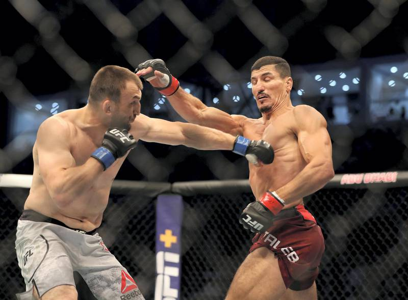 Abu Dhabi, United Arab Emirates - September 07, 2019: Welterweight bout between Nordine Taleb and Muslim Salikhov (grey shorts, winner) in the Early Prelims at UFC 242. Saturday the 7th of September 2019. Yas Island, Abu Dhabi. Chris Whiteoak / The National