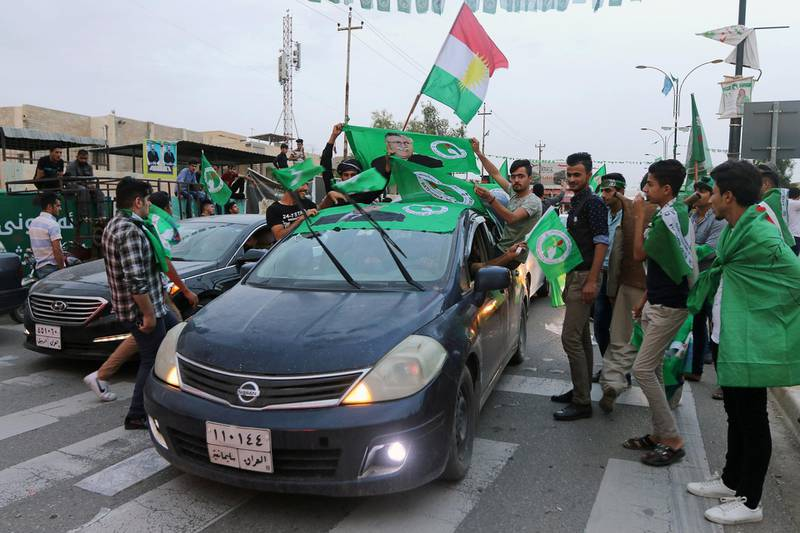 Kurdish supporters of the Patriotic Union of Kurdistan (PUK) celebrate after the closing of ballot boxes during the parliamentary election in Kirkuk, Iraq, May 12, 2018. REUTERS/Ako Rasheed