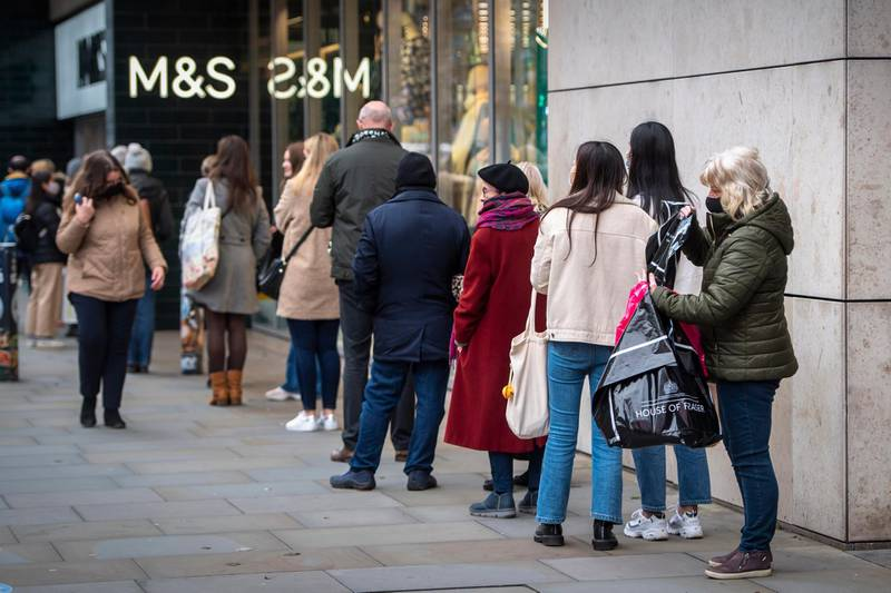 MANCHESTER, ENGLAND - DECEMBER 22: People queue for food orders outside a Marks & Spencer store in Manchester city centre on December 22, 2020 in Manchester, England. A new strain of the Covid-19 virus has led to France closing ports to British goods for 48 hours from Sunday night.  This has led to a number of UK supermarkets warning of potential food shortages just a few days before Christmas. (Photo by Anthony Devlin/Getty Images)