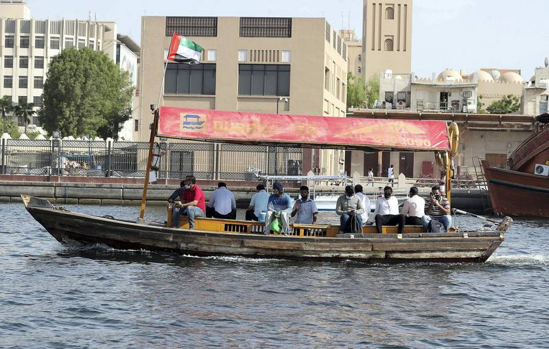 DUBAI, UNITED ARAB EMIRATES , July 2– 2020 :- People wearing protective face mask on the Abra in Dubai Creek in Dubai. (Pawan Singh / The National) For News/Standalone/Online/Stock