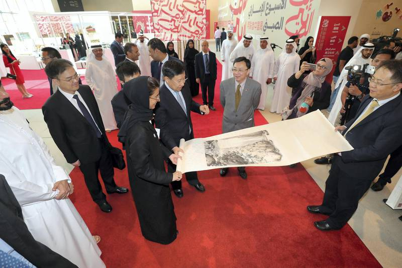 Abu Dhabi, United Arab Emirates - July 15, 2018: Week of UAE/China events to build up the State Visit of Xi Jinping. A cultural day with Noura Al Kaabi is presented with a scroll by Chinese Minister Wang Xiaohui (2nd R) and Ni Jian (UAE Chinese ambassador). Sunday, July 15th, 2018 in Manarat Al Saadiyat, Abu Dhabi. Chris Whiteoak / The National